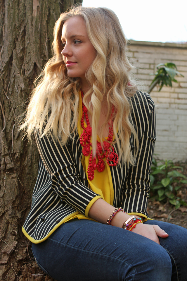 Striped blazer and bold necklace