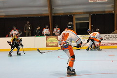 ice hockey(0.0), ice hockey position(0.0), ball game(0.0), bandy(0.0), stick and ball games(1.0), ball hockey(1.0), sports(1.0), roller in-line hockey(1.0), team sport(1.0), hockey(1.0), defenseman(1.0), college ice hockey(1.0), athlete(1.0),