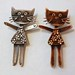 Kitty brooches