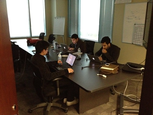 Hacking away in the conference room.