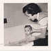 Baby's bathtime snapshot, Bronx, New York by Robert Barone