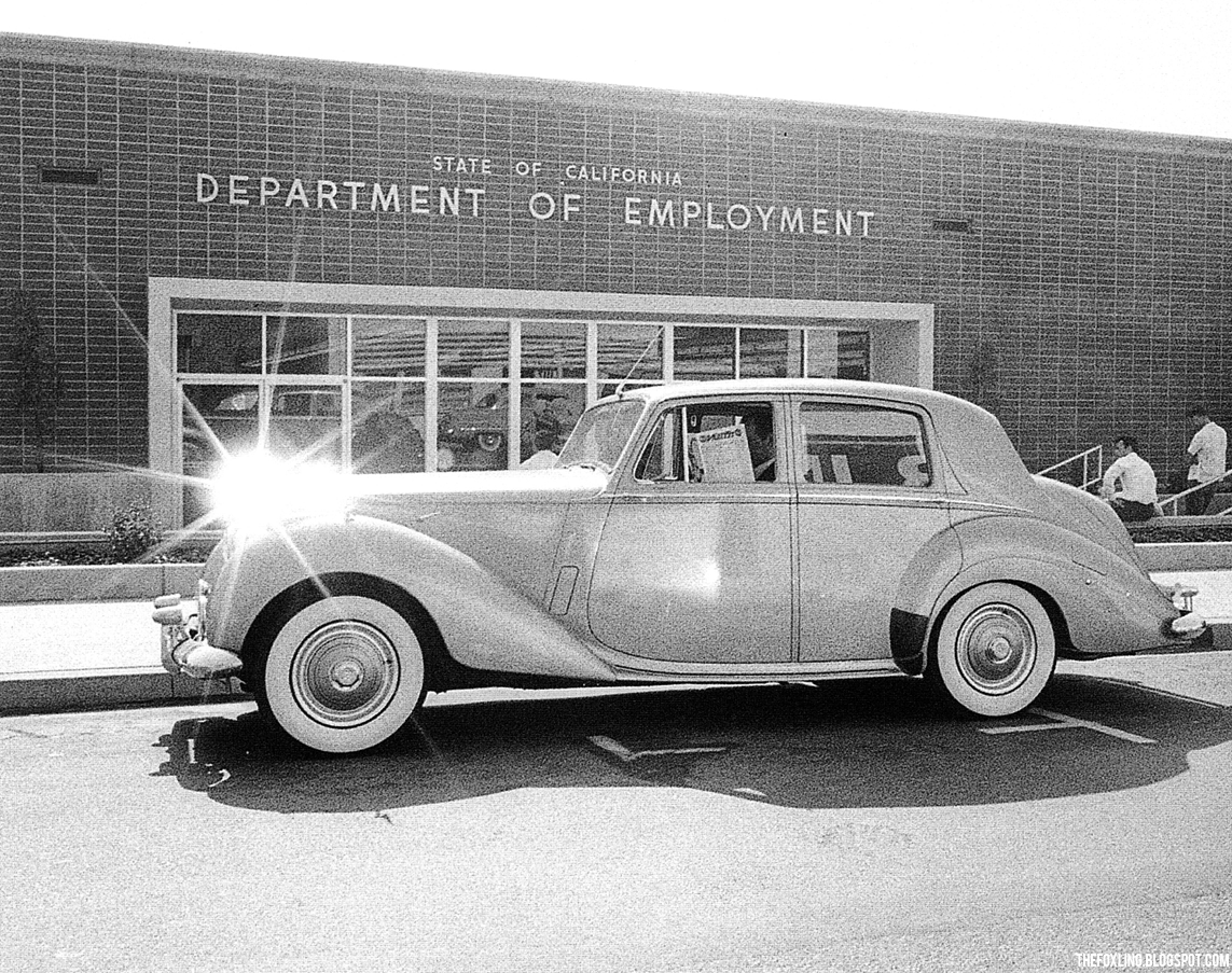 A Rolls- Royce outside the Department for Unemployment