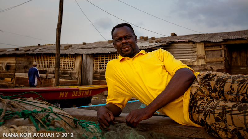 Beninoise Fisherman rests on his canoe in Cameroon