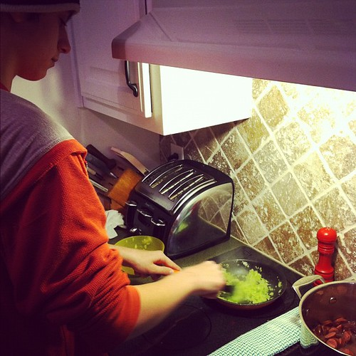 My favorite teenager in the kitchen cooking red beans, sausage, and rice. #iknewihadkidsforareason