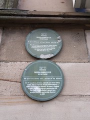 Photo of Middlesbrough railway station and William Peachy green plaque