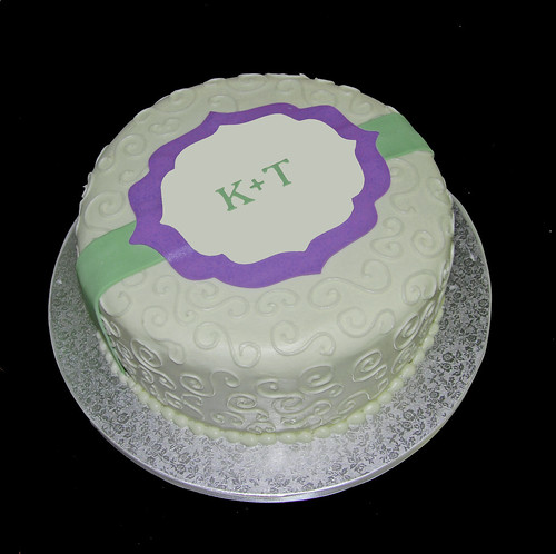 cream and purple bridal shower cake