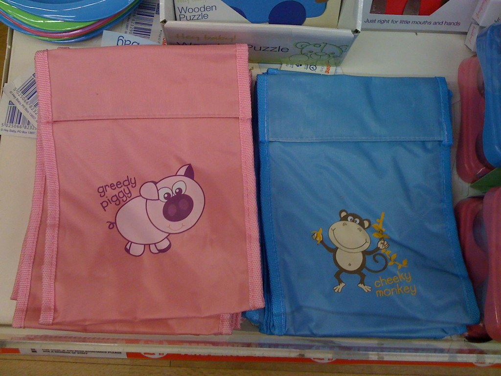 Photo of pink and blue lunchbags for kids, with blue showing 'cheeky monkey' and pink showing 'greedy piggy'