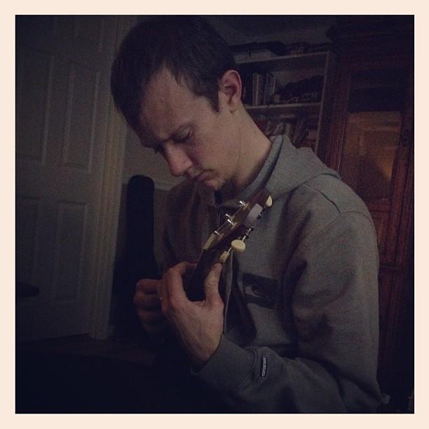 Collin playing around on his ukulele.