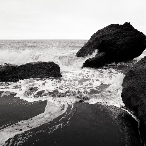 "Image titled ""Black sand and cresting waves, Vík beach, Iceland."""