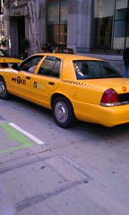 Fake NYPD and NY taxi cabs block Spring Street bike lane during film shoot