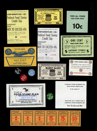 A collection of stamps and coupons from the U.S. Department of Agriculture Food Stamp Programs. Photo courtesy of Smithsonian Institution, National Museum of American History.