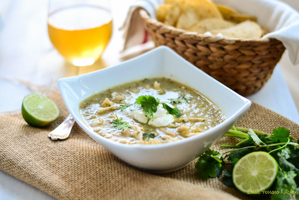 Serve chicken chili verde recipe with a dollop of sour cream and tortilla chips.