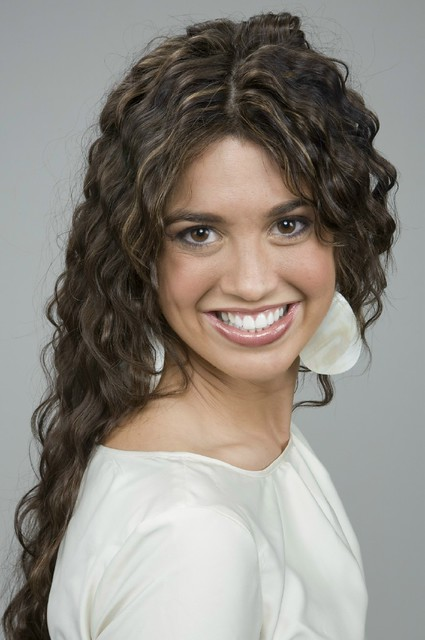 Long, curly brown hair  with highlights