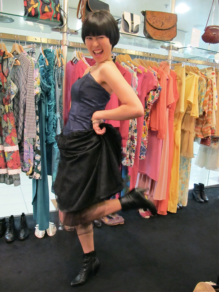We love X-Wens energy! This 1980s bustier party dress with tulle paired with high-heeled black leather boots will put anyone in high spirits!