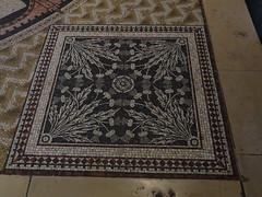 textile(0.0), prayer rug(0.0), carpet(0.0), floor(1.0), art(1.0), mosaic(1.0), flooring(1.0),