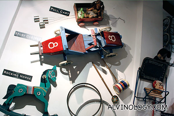 Rocking horse, pull cart and other yesteryears toys adorn the wall on the second floor