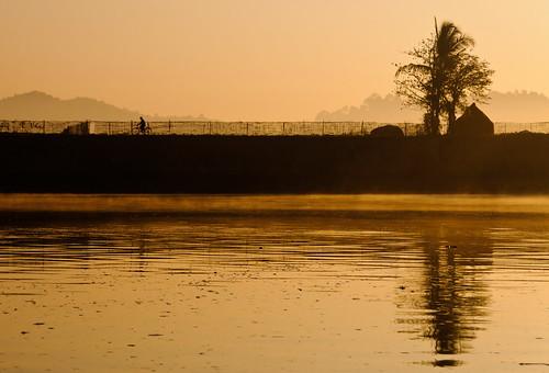 silhouette sunrise work river cycling nikon commerce cyclist village burma traditional myanmar burmese banks rakhine arakan lemroriver lemro d300s silhouettephotography panmraun