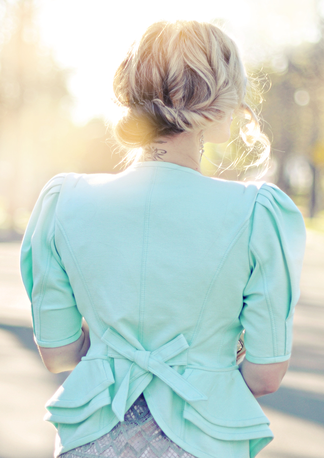 mint jacket-peplum- curled updo hair style