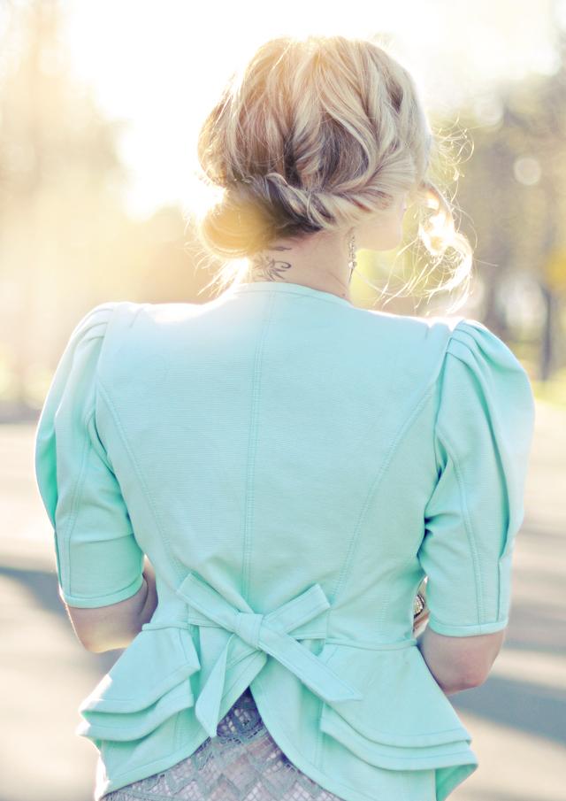 mint jacket-peplum- curled updo hair style