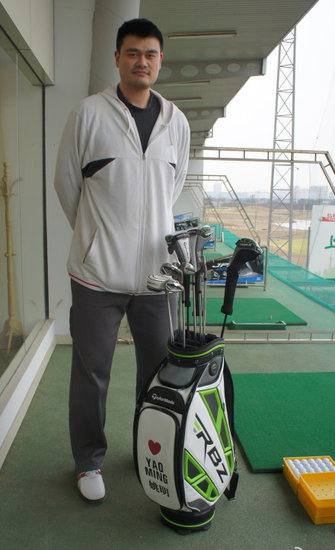 March 9th, 2012 - Yao Ming is at a Shanghai driving range