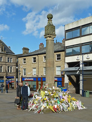Flowers at the Market Cross, Huddersfield by Tim Green aka atoach