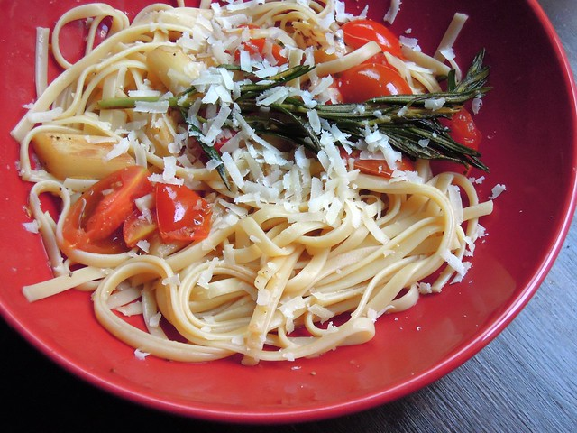 Tagliatelle with white asparagus, cherry tomatoes, rosemary and fresh parmesan