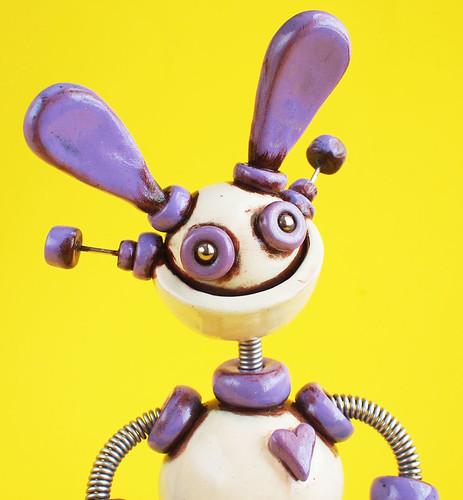 Easter Grungy Lavender Lawrence Robot Sculpture by HerArtSheLoves