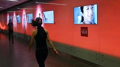 walking past a flashing wall of video ads in a Singapore mall by albatz