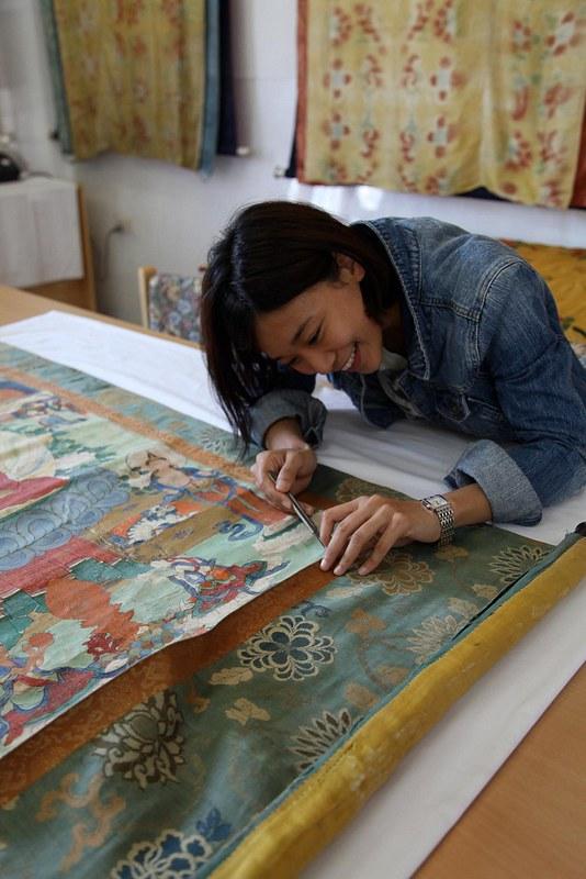 Princess Ashi Kesang restoring a thangka. Image courtesy Princess Ashi Kesang