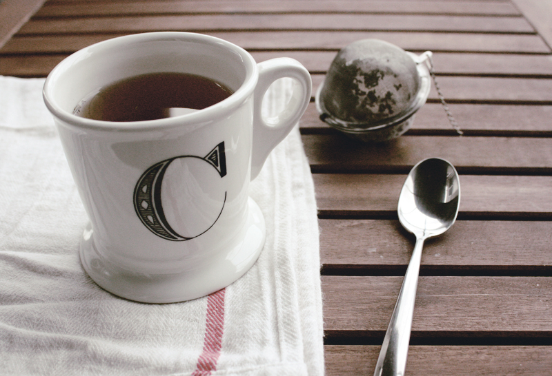 tea mug towel spoon relax break glass and sable