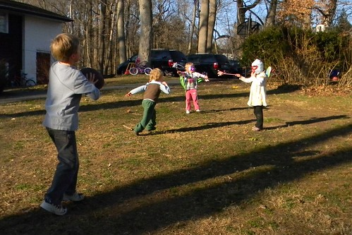 boys playing football, girls as fairies