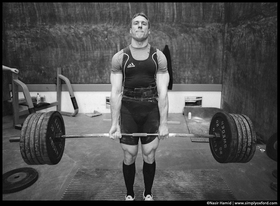 a man powerlifting