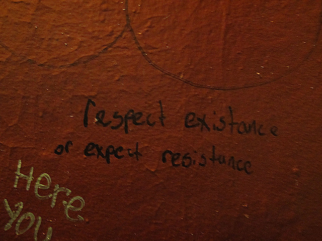 Respect existance or expect resistance; graffiti on Simple Pleasures bathroom wall; The Richmond, San Francisco (2011)