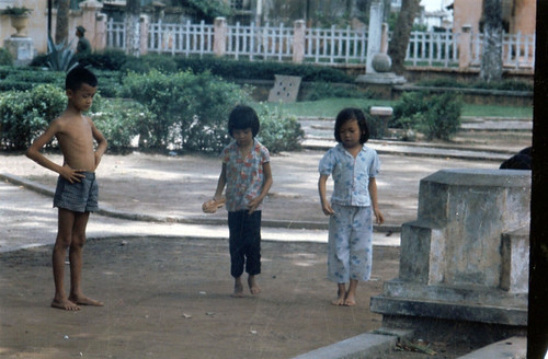 Vietnamese children playing games in Can Tho Park.