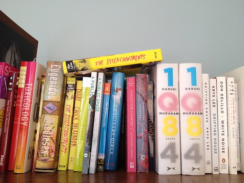 I totally organized my NYC bookshelf according to color.