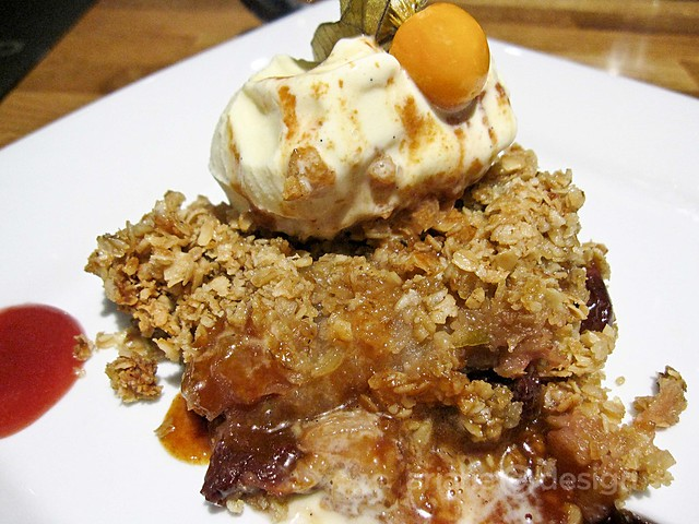 Apple and cherry crumble with vanilla ice creame