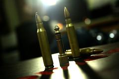 darkness(0.0), weapon(1.0), light(1.0), macro photography(1.0), close-up(1.0), lighting(1.0), ammunition(1.0),