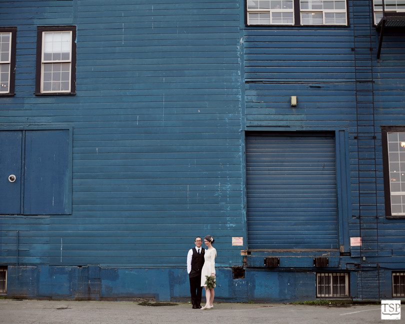 Bride and Groom in front of Blue Building
