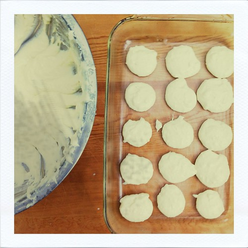 cheesy brazilian bread portioned on baking pans