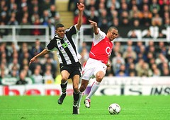 Gilberto (Arsenal) Jermaine Jenas (Newcastle). Newcastle United 1:1 Arsenal. The F.A. Barclaycard Premiership. St. James' Park, Newcastle, 9/2/2003. Credit : Stuart MacFarlane / Arsenal Football Club.    ...