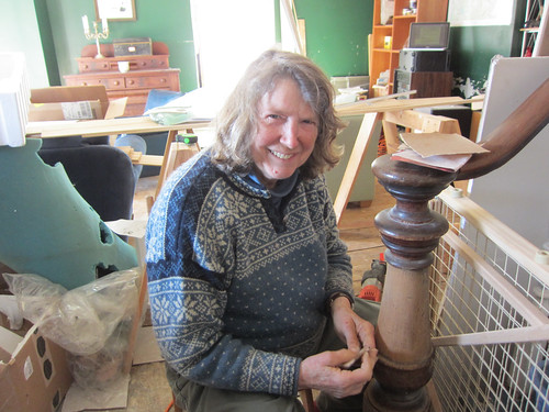 judy sanding the newel post