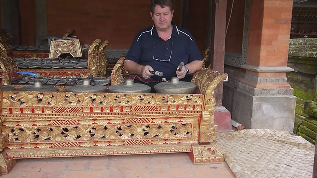 Graham playing Gamelan instruments