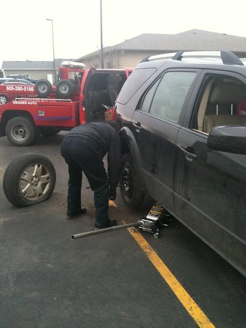 Flat tire.  Wegner auto tow truck.
