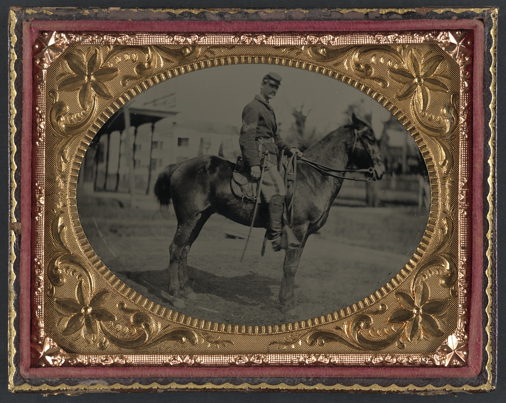 [Unidentified soldier in Union sergeant's uniform with sword seated on a horse] (LOC)