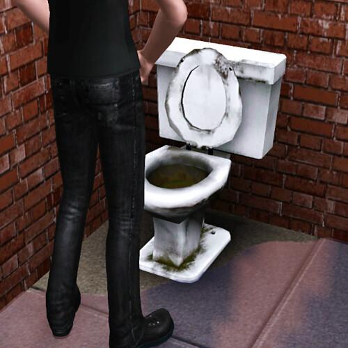 Aaron in a filthy bathroom