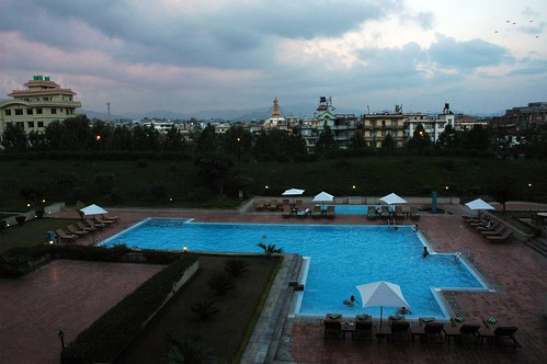 View of Boudha Stupa over the Hilton swimming pool, Hyatt Regency Kathmandu, Boudha, Kathmandu, Nepal by Wonderlane