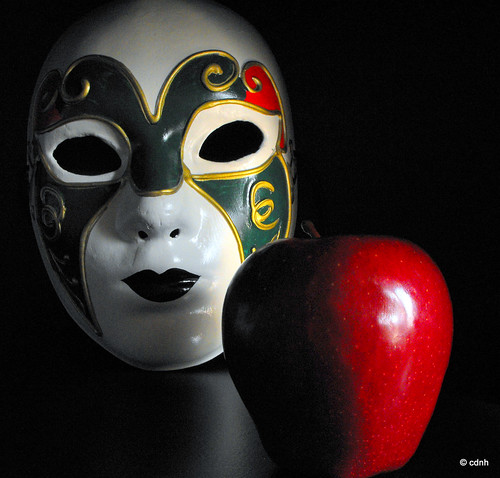 The white mask, the red apple & the black background by cdnh