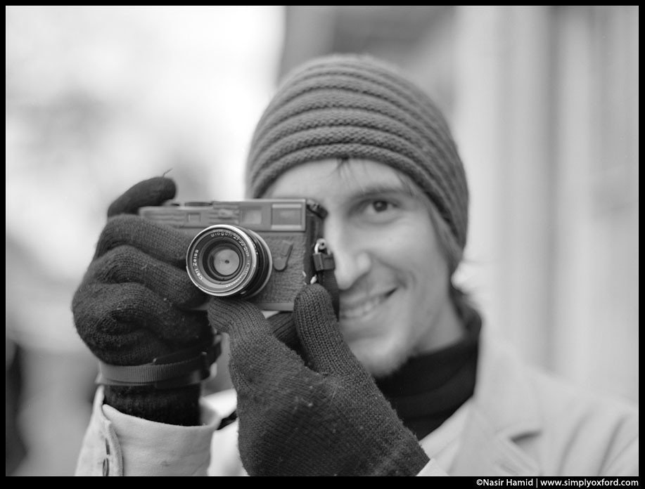 photographer holding a leica camera