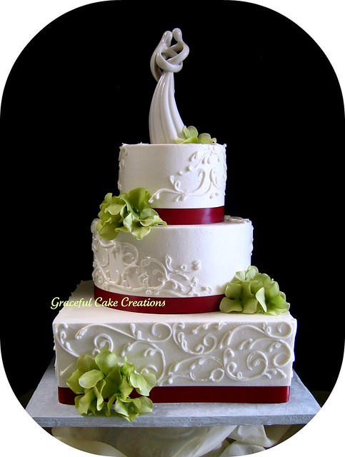 The cake was decorated with a scroll design highlighted with a pearl sheen