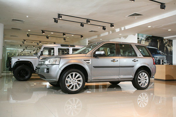 A Defender Stationwagon (L) and Freelander 2 on display in the Land Rover section of the new showroom